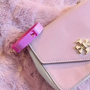 tory burch x Fitbit • pink Fitbit holder bracelet